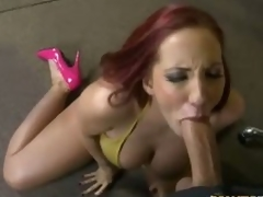Redhead milf Kelly Divine in pink high heels has oral sex