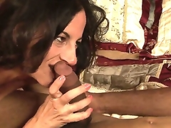 Lusty turned on dark brown milf Melissa Monet with natural hanging meatballs gives head to dirty black fellow and rides on his schlong in bedroom while her hubby is at work.