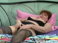 Barbara was just getting willing for bed but stripping her clothes off and seeing her sexy black nylons actually made her horny. She then begins massaging her juicy jugs and finger fucking her bushy box to orgasm.