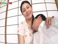 Censored movie scene of a Japanese MILF gender a much younger man